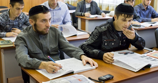 As an attempt to resolve problems in North Caucasus and improve its image, Russia's authorities promote education in the region on federal level. Pictured: Students during their classes in the Russian Islamic University in Grozny, the Chechen capital