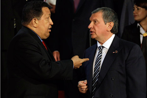 Despite Hugo Chavez's presidential victory the risks for Russia's private oil companies are too high. Pictured (L-R): Venezuelan President Hugo Chavez and Rosneft's Head Igor Sechin. Source: AP