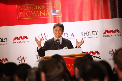 Yuan Tian, chairman of the China Entrepreneurs Forum, speaking at the recent M&A summit in New York. Source: Press Photo