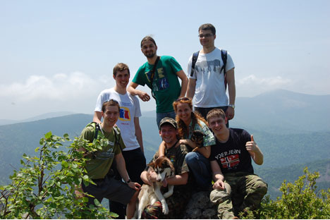 Jakub Kachelmaier (left in green T-shirt) and friends with Russian hosts on a mountain outside of Vladivostok. Source: From personal archives.