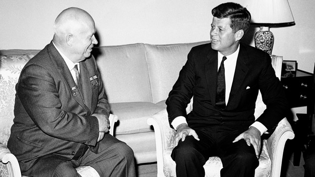 Pictured (L-R): Soviet Premier Nikita Khrushchev and President John F. Kennedy talk in the residence of the U.S. Ambassador in a suburb of Vienna in June, 1961. Source: AP