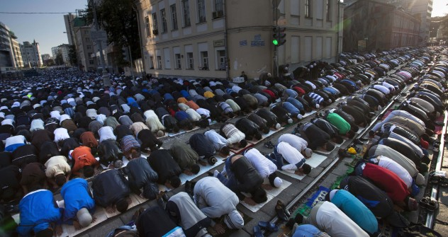 Muslim men, bowing toward Mecca, perform Eid al-Fitr prayers that marks the end of the holy fasting month of Ramadan in Moscow, Russia, Sunday, Aug. 19, 2012. Source: AP