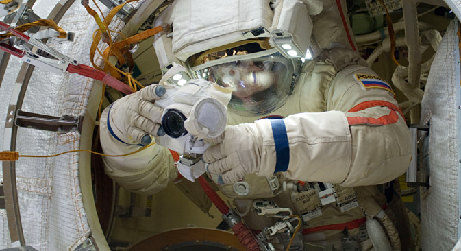 ISS cosmonauts Gennady Padalka (pictured) and Yuri Malenchenko had to make a several spacewalks to  investigate the behavior of different life forms in outer space. Source: NASA / Press Photo