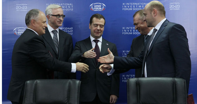 Russia's Prime Minister Dmitry Medvedev (in the middle) during the 2012 Sochi Investment Forum. Source: ITAR-TASS