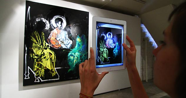 "The ""Spiritual Clash"" exhibition presents ""relevant icons"" depicting  saints wearing balaclavas, portraits of the Pussy Riot members with halos, and a representation of the Savior with a female face. Source: ITAR-TASS"