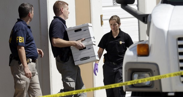FBI agents carry boxes out of Arc Electronics Inc. on Oct. 3, 2012 in Houston. A Kazakhstan-born businessman was charged in the U.S. with being involved in a recent spy scandal between Russia and the U.S. Source: AP Photo / David J. Phillip