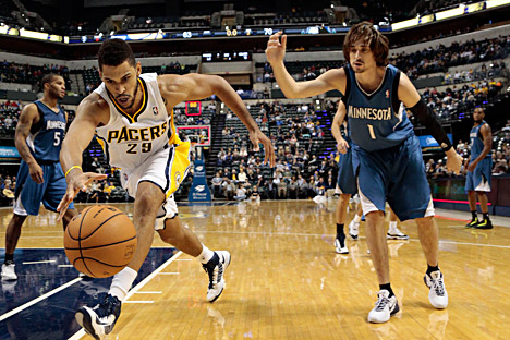 Indiana Pacers forward Jeff Pendergraph, left, chase down a loose ball in front of Minnesota Timberwolves guard Alexey Shved during the second half of a preseason NBA basketball game on Oct. 12 in Indianapolis. The Pacers won 96-91. Source: AP