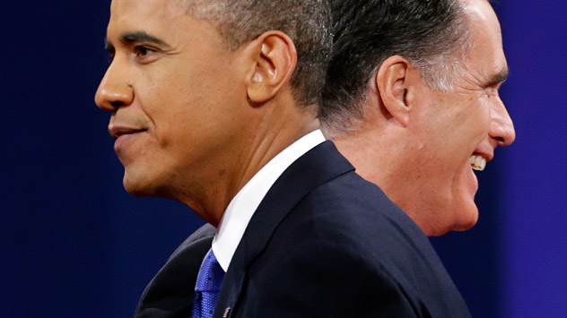 Republican presidential candidate, former Massachusetts Gov. Mitt Romney and President Barack Obama walk past each other on stage at the end of the last debate at Lynn University, Monday, Oct. 22, 2012, in Boca Raton, Fla. Source: AP