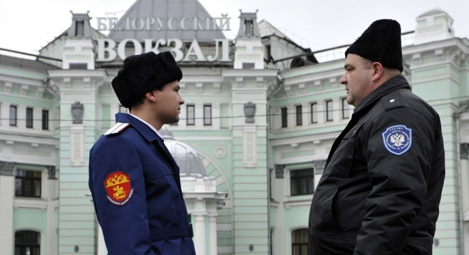 Cossacks assist the police by patrolling Moscow streets and targeting illegal traders. Yet their recent unsanctioned campaign in Belarussky Railway Station brought about more mess than order. Source: ITAR-TASS / Sergey Bobylev