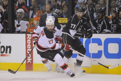 New Jersey Devils left wing Ilya Kovalchuk (17) and Los Angeles Kings center Jeff Carter (77) are seen in the first period during Game 3 of the NHL hockey Stanley Cup Finals, Monday, June 4, 2012, in Los Angeles. Source: AP