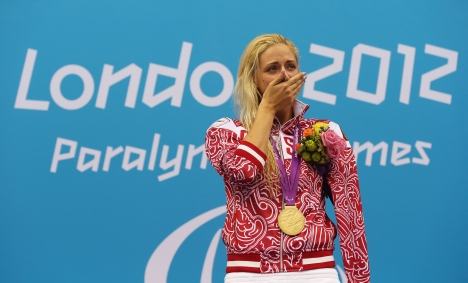 Gold medallist Olesa Vladykinsa of Russia poses on the podium during the medal ceremony for the Women's 100m Breaststroke - SB8 Finalon day 3 of the London 2012 Paralympic Games at Aquatics Centre on September 1, 2012 in London, England. Source: Getty Images / Clive Rose