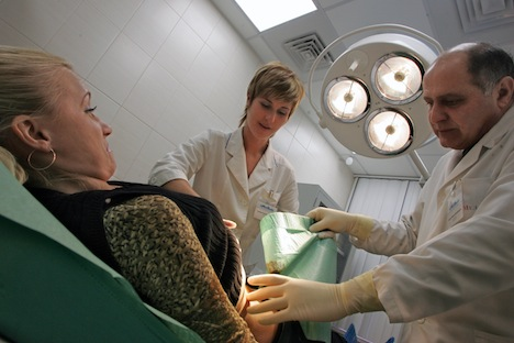 Starting Jan. 1, Russians have to pay for every service that is not part of the compulsory health insurance standard package, including visits to specialists. Source: Kommersant