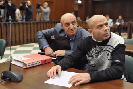 Former Lieutenant Colonel Pavlyuchenkov (right) jailed for 11 years for organizing surveillance of Anna Politkovskaya, famous investigative reporter, killed in the elevator of her apartment building in Moscow on Oct. 7, 2006. Source: Kommersant