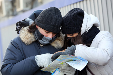 Most lists of winter gear include hats, gloves, long coats and boots. Source: PhotoXPress.