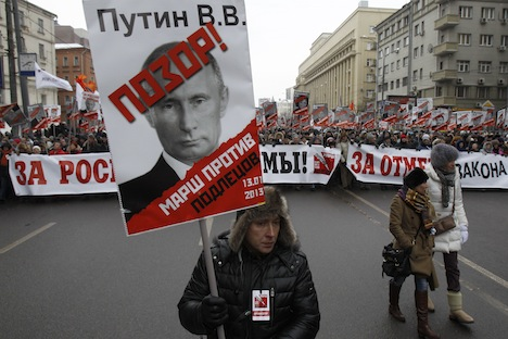 "Russians turned up for a march in Moscow on Sunday to protest against a ban on adopting Russian children by Americans. The placard featuring a portrait of Russian President Putin says, ""Shame on Putin! March against scoundrels"". Source: Reuters"