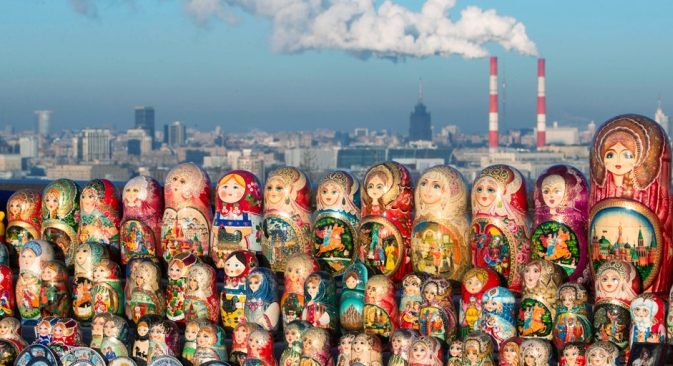 Matryoshkas, traditional Russian wooden dolls, are displayed for sale on a cold winter day in the Sparrow Hills, the site of tourist attraction in Moscow, Wednesday, Dec. 12, 2012. Temperature is about -10 C (14 F). Source: AP