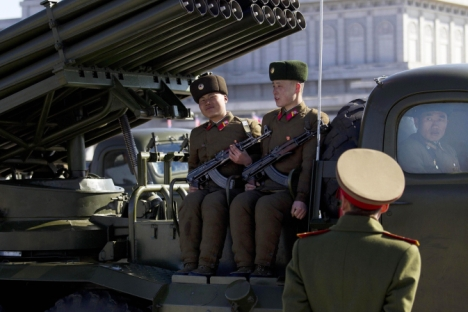 A North Korean soldier smiles from the back of an army vehicle at Kumsusan Memorial Palace in Pyongyang, North Korea, before a parade of thousands of soldiers commemorating the 70th birthday of the country's late leader Kim Jong Il. Source: AP