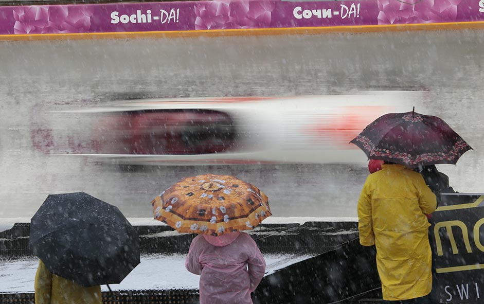 Spectators watch competitions during the 4 men's Bob event at the FIBT Bob & Skeleton World Cup 2013, Sochi.