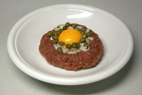 Tartare — a generous portion of raw minced beefsteak, mixed with an egg yolk and flavorsome marinade sauce. Source: Lori / Legion Media