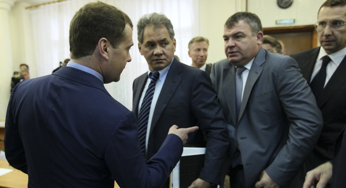 Dismissed Defense Minister Anatoly Serdyukov (second right) came under scrutiny over questionable contracts. Source: Reuters
