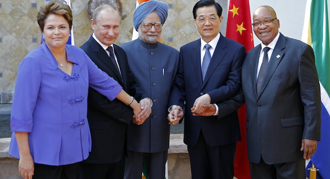 "The leaders of the BRICS countries are going to address problems of the creation of a new development bank and so-called ""virtual secretariat"" during the next summit in South Africa. Source: AP"
