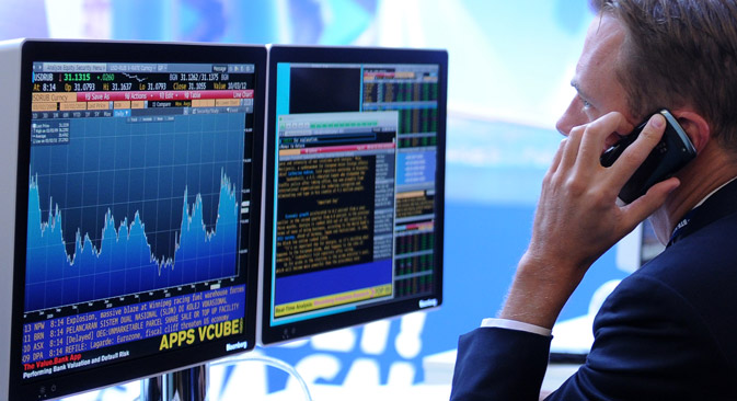 "A screen displaying stock exchange graphs and and diagrams at the VTB Capital Fourth Annual Investment Forum ""Russia Is Calling!"". Source: RIA Novosti / Alexey Filippov"