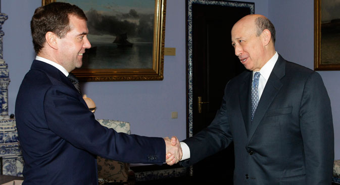 Russian President Dmitry Medvedev, left, shakes hands with Goldman Sachs Chief Executive Officer Lloyd Blankfein during a meeting in the Gorki residence outside Moscow, Tuesday, March 15, 2011. Source: AP Photo/RIA Novosti, Vladimir Rodionov