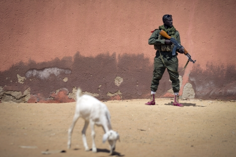 Russia accounted for 11 percent of the volume of major arms supplied to sub-Saharan Africa in December 201, according to a SIPRI report. Pictured: A Malian army soldier holding an AK-47 assault rifle. Source: AFP / East News