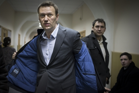 Russian opposition activist Alexei Navalny prepares to speak to journalists outside a courtroom in Moscow, Russia, Wednesday, March 13, 2013, after his appeal against the country's top investigative agency was rejected. Source: AP