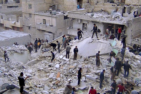 Syrian citizens search for dead bodies on the rubble of damaged buildings that were attacked by Syrian forces airstrikes, at al-Zarazir neighborhood, in Aleppo, Syria. Source: AP