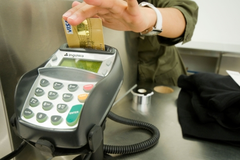 Cash-free payments will result in higher prices for some goods and services, according  to experts. Source: PhotoXPress
