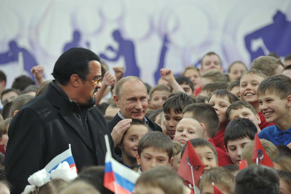 Russian President Vladimir Putin and American actor Steven Seagal during the opening of sport center 'Sambo-70' in Moscow, March 13, 2013.