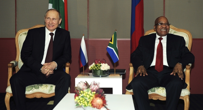 South African President Jacob Zuma (R) meets Russian President Vladmir Putin before their bilateral meeting the 5th BRICS Summit in Durban, March 26, 2013. Source: Reuters