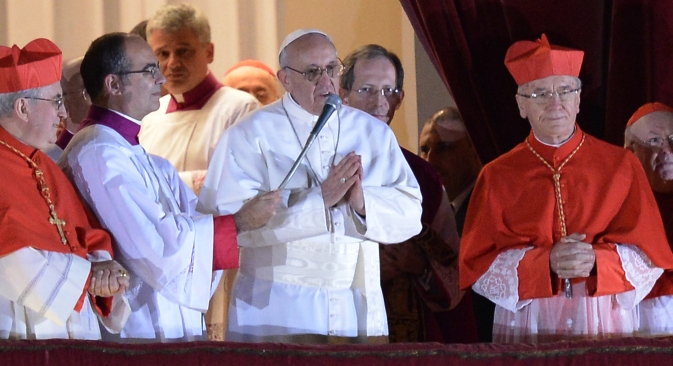 Argentina's cardinal Jorge Bergoglio, elected Pope Francis I addresses the crowd on the balcony of St Peter's Basilica's after being elected the 266th pope of the Roman Catholic Church on March 13, 2013 at the Vatican. Source: AFP