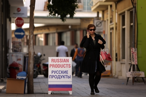 Russian-language signs can be observed in Europe, especially, in debt-ridden countries like Cyprus [pictured] which have eased visa and residency permit requirements for Russia's wealthy shoppers. Source: AFP / East News