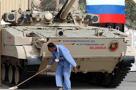 A man cleans the exhibition stand of the BMP-3 Russian tank during the opening day of the International Defence Exhibition & Conference, IDEX, in Abu Dhabi, United Arab Emirates. Source: AP