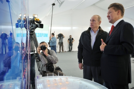 "Then-Prime Minister Vladimir Putin (left) and Gazprom CEO Aleksei Miller (right) observing the Nord Stream Project information mount at the gas compressor station ""Portovaya in September in 2011. Source: RIA Novosti / Alexey Nikolsky"