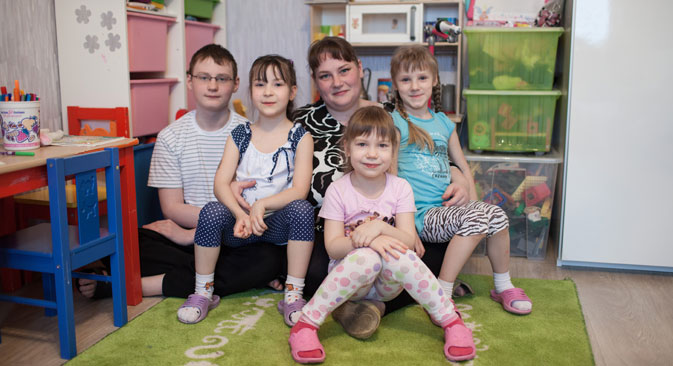 Family values: Yelena at home with (left to right) Andrei, Praskovya, Yulia and Marina Source: Sergei Savostianov