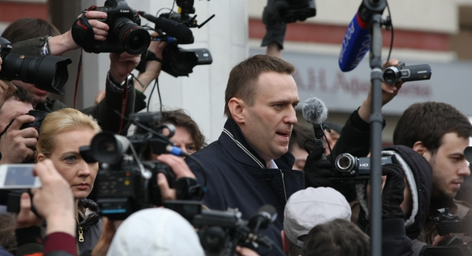 Russian opposition leader Alexey Navalny speaks to journalists after the Kirov court postponed his trial until April 24. Source: RIA Novosti / Maksim Bogodvid