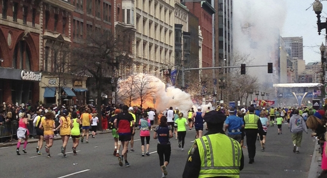 Two simultaneous explosions ripped through the crowd at the finish line of the Boston Marathon on Monday, killing at least two people and injuring dozens. Source: Reuters / Dan Lampariello