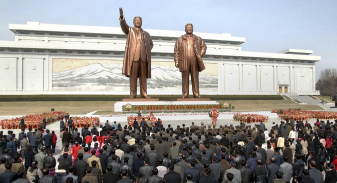North Korean soldiers, workers and students place flowers before the statues of North Korean founder Kim Il-sung (left) and his son, late leader Kim Jong-il, on the 101st anniversary of Kim Il-sung's birth, in Pyongyang. Source: Reuters