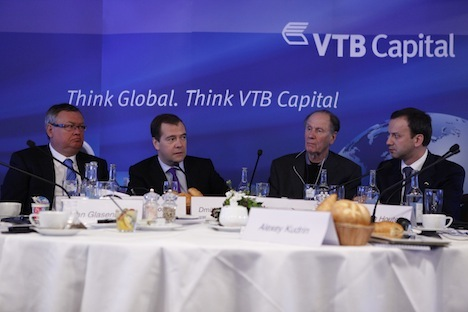 VTB Head Andrei Kostin (L) during the 2013 World Economic Forum. Pictured (L-R): Russia's Prime Minister Dmitry Medvedev, Co-founder of TPG David Bonderman and Deputy Prime Minister Arkady Dvorkovich. Source: ITAR-TASS