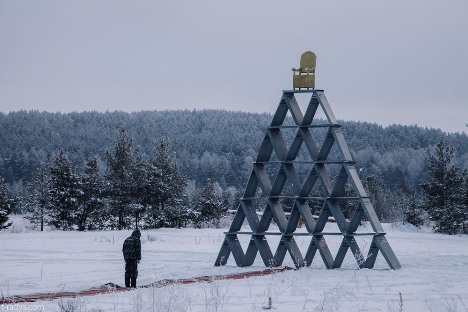 "The sculpture ""Figure #1: Stability"" is a huge pyramid made of police riot shields. Source: www.t-radya.com"