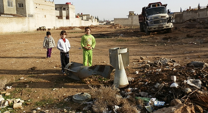 Moscow hopes that the 2013 G8 summit will contribute to tackling the Syrian standoff. Pictured: Children standing near the remnants of a bomb shell in the ground near Damascus. Source: Reuters