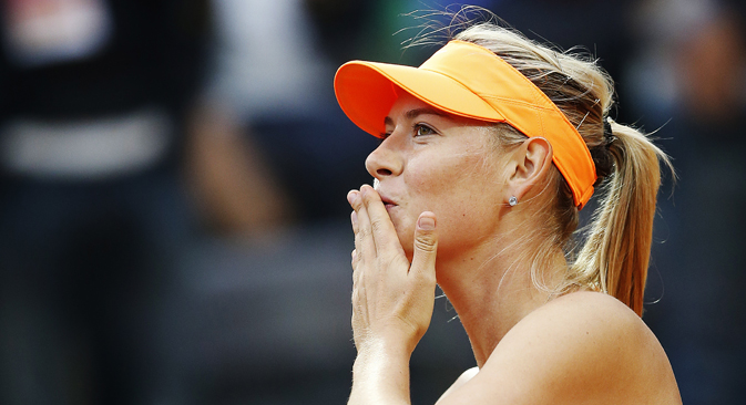 Maria Sharapova blows a kiss to spectators after defeating Garbine Muguruza of Spain in their women's singles match at the Rome Masters tennis tournament on May 15. Source: Reuters