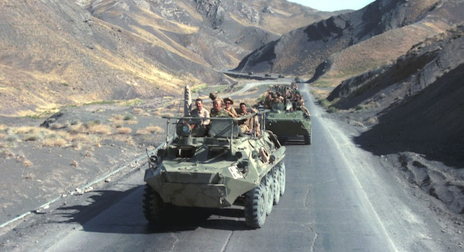 A column of armoured personnel vehicles rides on the way from Herat to Kushka as Soviet troops return home from Afghanistan in 1988. Source: ITAR TASS / Vladimir Zavyalov