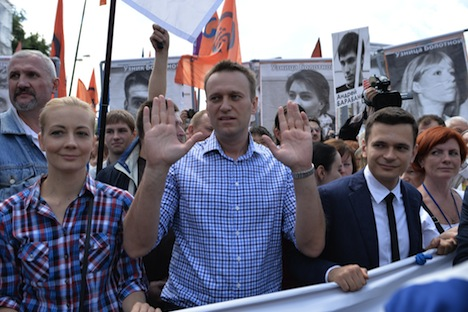 Opposition leader Alexei Navalny, center, and his wife, Yulia, and Ilya Yashin, right, member of the RPR-PARNAS federal political council's bureau, takes part in an opposition rally in central Moscow. Source: RIA Novosti / Ilya Pitalev