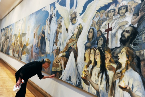"A researcher observes the preliminary drawing for the ""Joy righteous God. Triptych"" at an exhibition of Viktor Vasnetsov at the Tretyakov Gallery. Source: RIA Novosti / Vladimir Vyatkin"