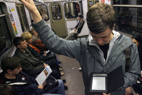 More and more people prefer to read from the screens of computers, smartphones, tablets, and e-readers, or even listen to audio books in their cars. Source: ITAR-TASS