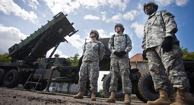 U.S. soldiers stand on May 26, 2010 in front of a Patriot missile battery at an army base in the northern Polish town of Morag. Source: AFP / East News